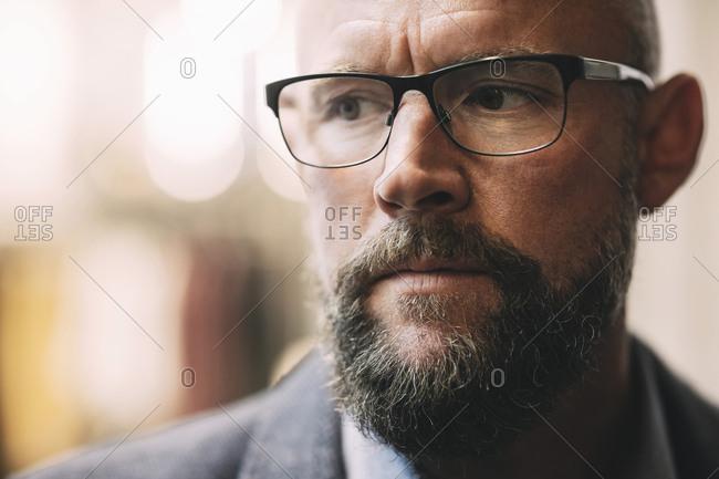 Close-up of thoughtful mature businessman wearing eyeglasses