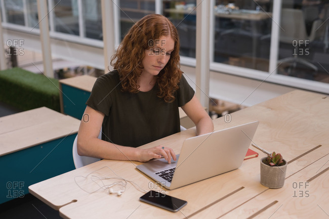 Female executive working at desk in office