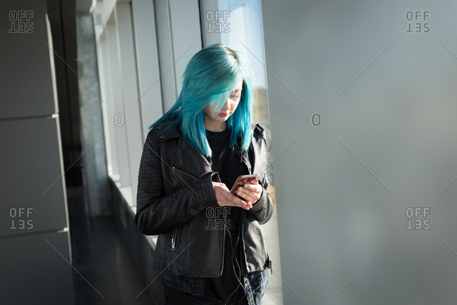 Stylish woman using mobile phone