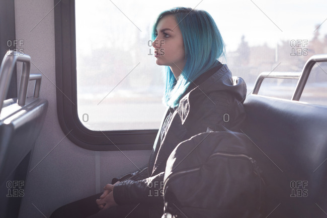 Thoughtful stylish woman travelling in train