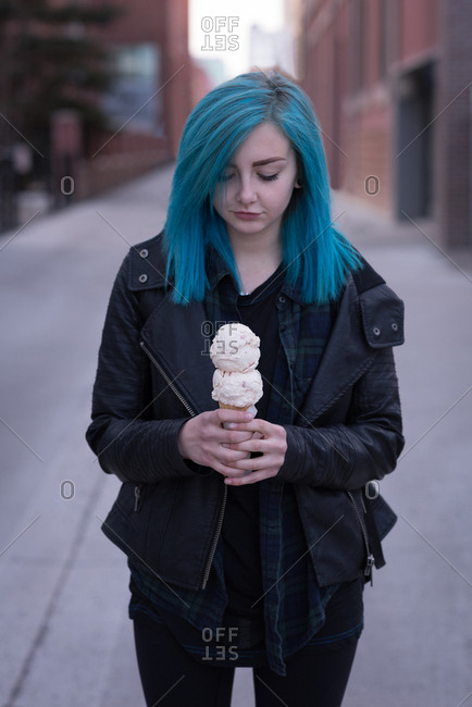 Stylish woman holding an ice cream in city street
