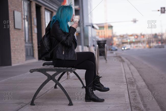 Stylish woman having ice cream in city street