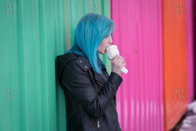 Stylish woman having ice cream on a sunny day