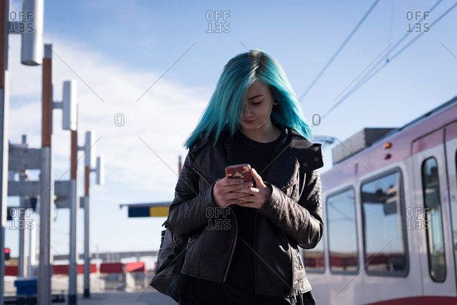 Stylish woman using mobile phone