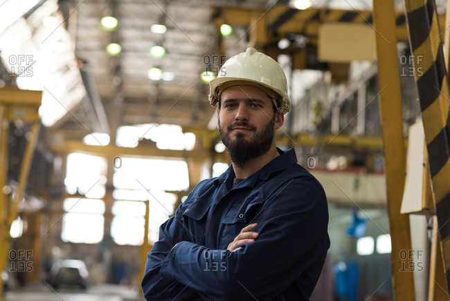 Portrait of confident technician standing with arms crossed in metal industry
