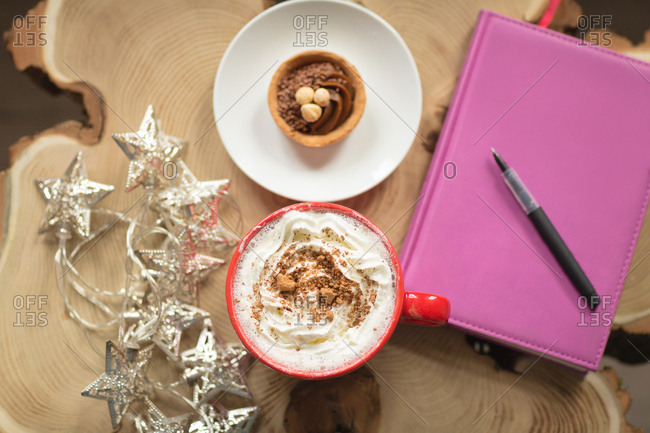 Sweet food and diary with pen on a table at home