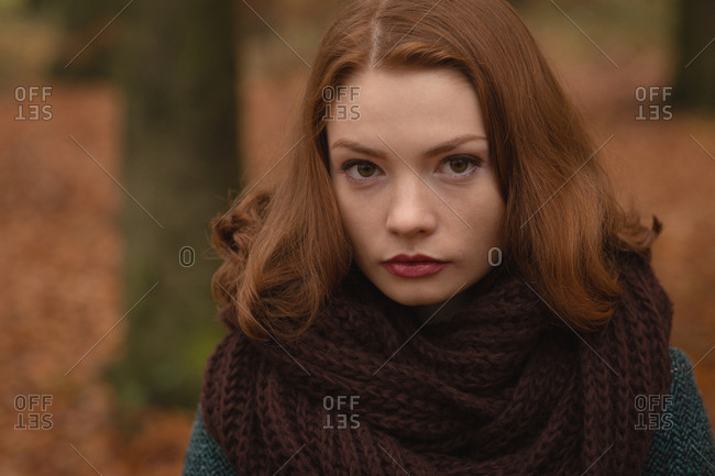Portrait of woman standing in the park during autumn