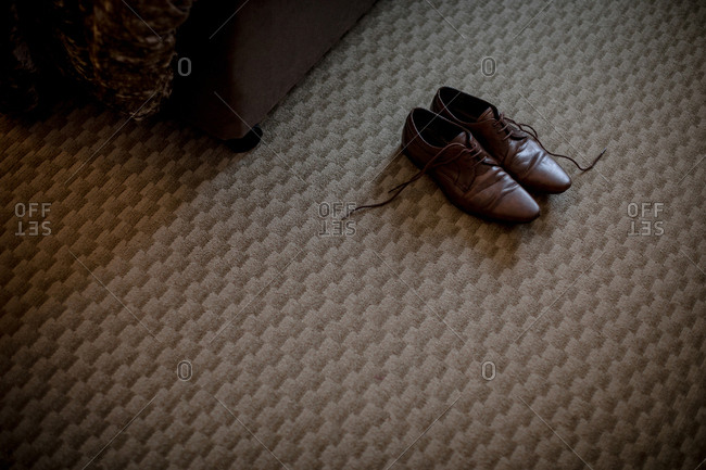 Pair of brown shoes in hotel room