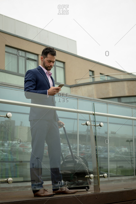 Businessman using mobile phone in hotel premises