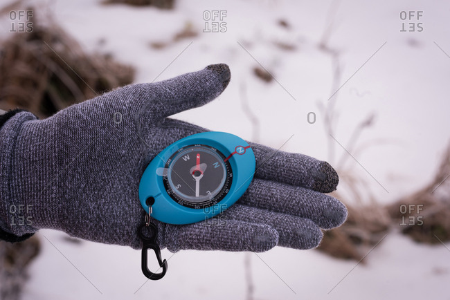 Close-up of woman hand holding compass