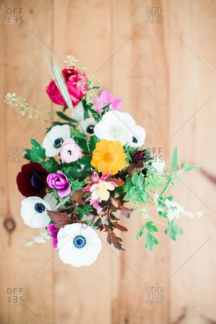 A bouquet of fresh flowers on a wooden table