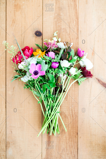 A bunch of fresh flowers on wood