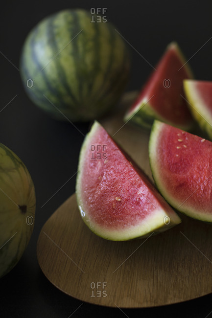 Whole watermelon and sliced wedges