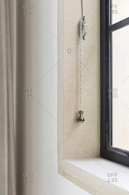 Open blinds window corner detail