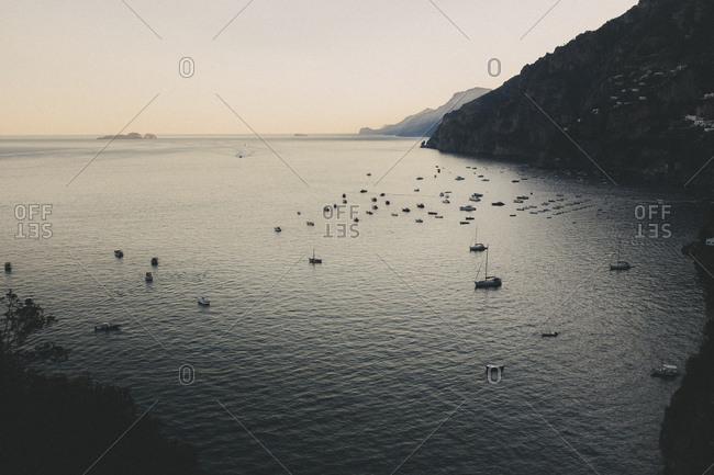 Boats on still bay at sundown