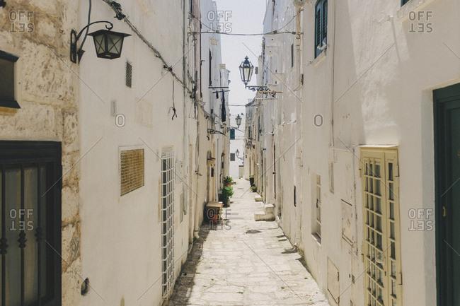 Narrow city alley in Italy
