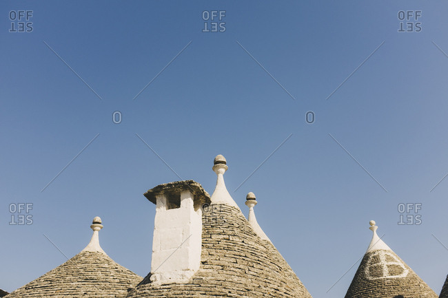 Stone rooftops against blue sky