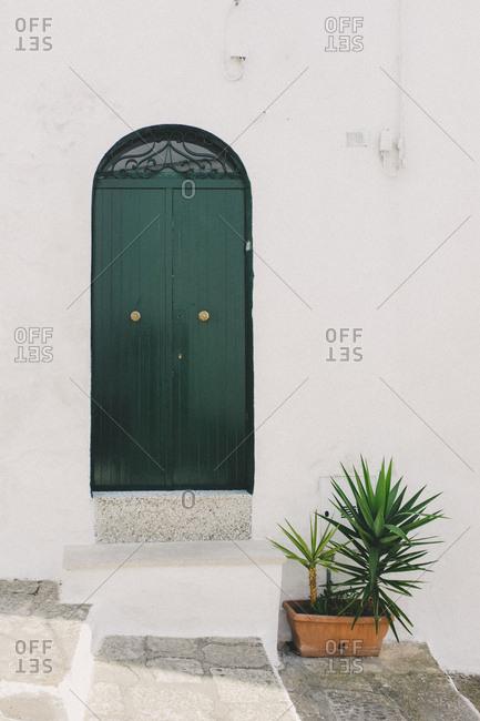 Stucco building exterior with decorative arched door