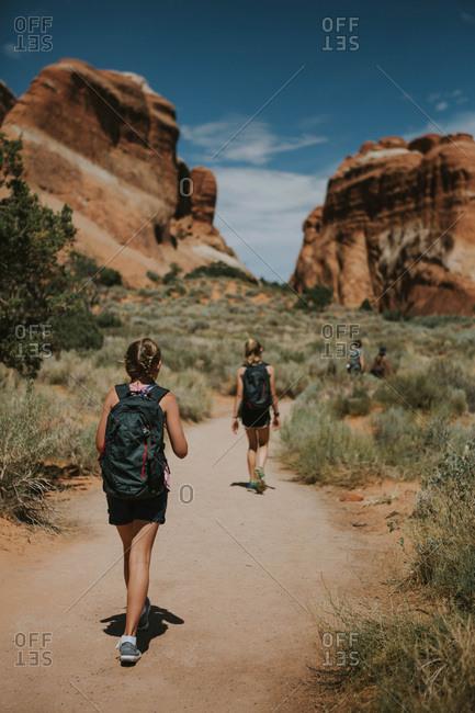 Girls hiking though canyons in rural Utah