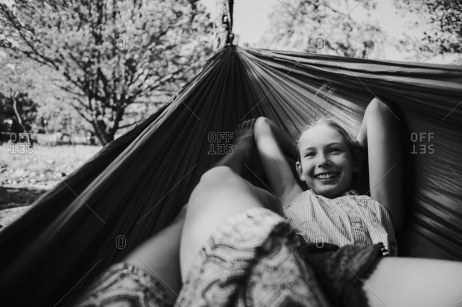 Black and white image of a girl in a hammock