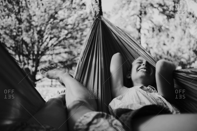 Laughing girl in a hammock in black and white