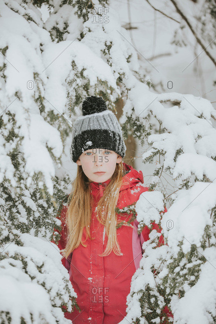 Portrait of a young blonde girl in the snow