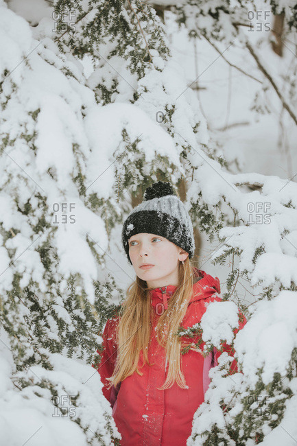 Young blonde girl in the snow