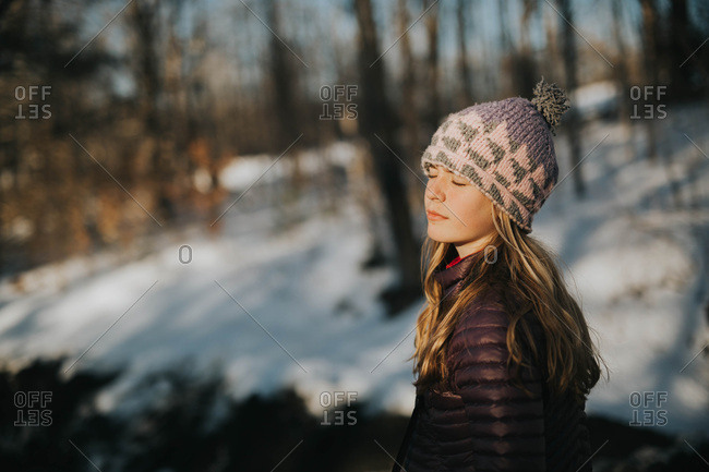 Young girl facing the sunlight