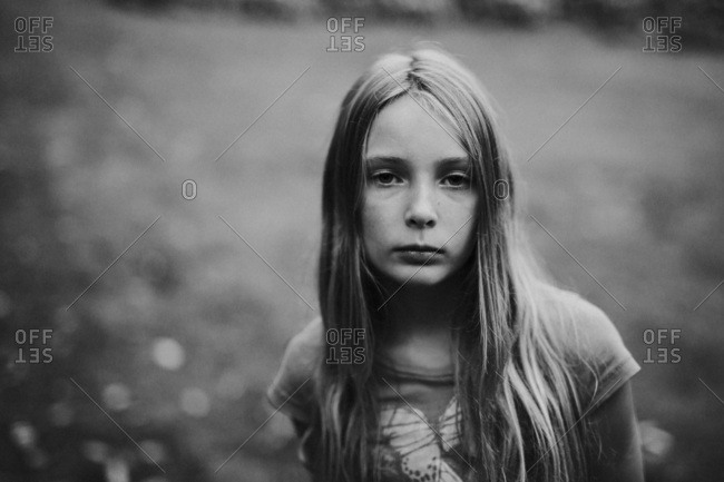 Black and white portrait of a girl with long blonde hair