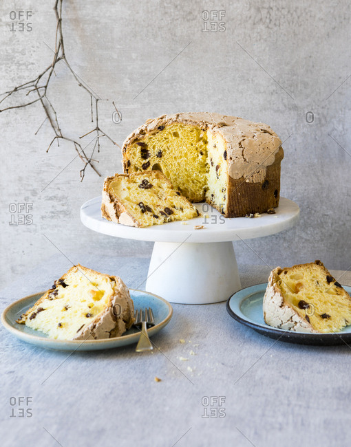 Pannetone cake on a stand with plated slices