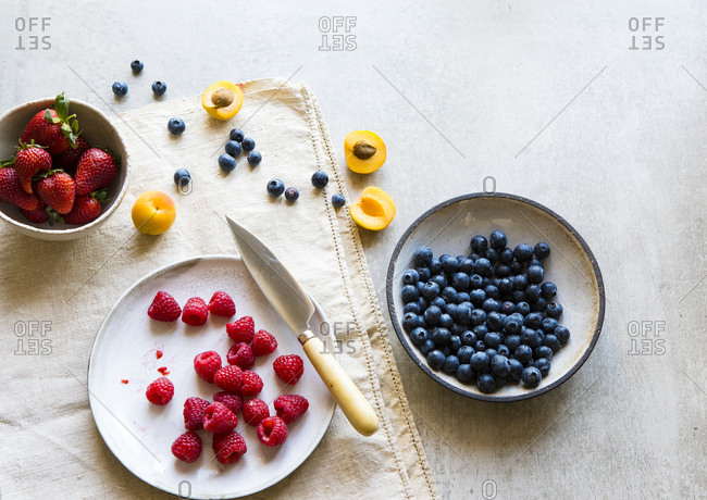 Overhead view of seasonal fruits in bowls