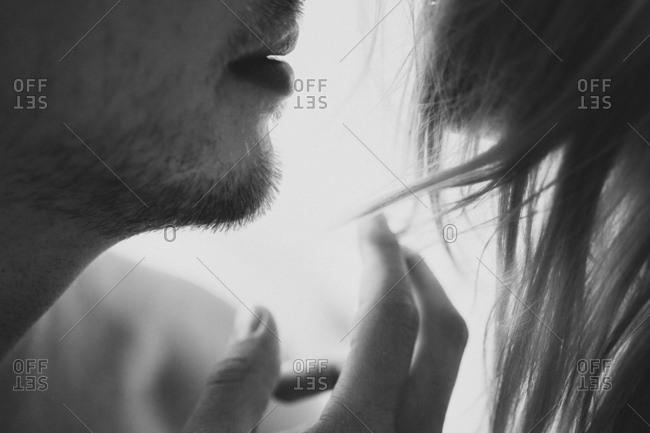 Man touches his lover's hair