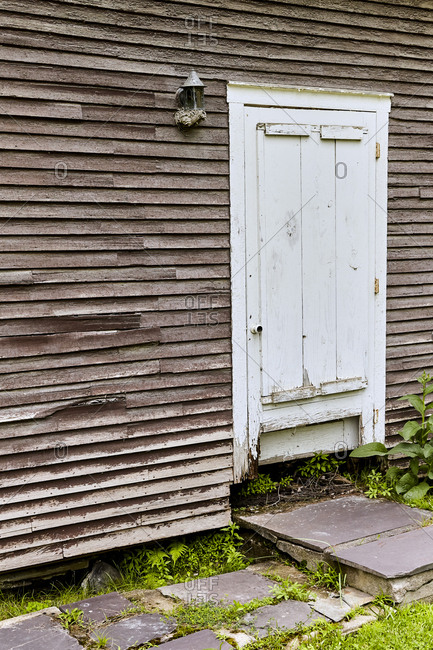 Weathered door on the side of a rustic wooden building