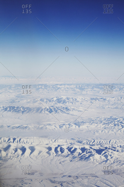 Scenic aerial view of snow-covered mountain ranges