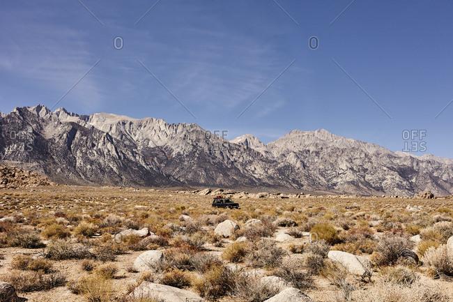 Car driving through desert valley