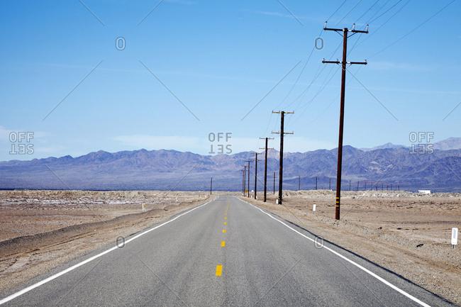 Two lane highway in desert valley