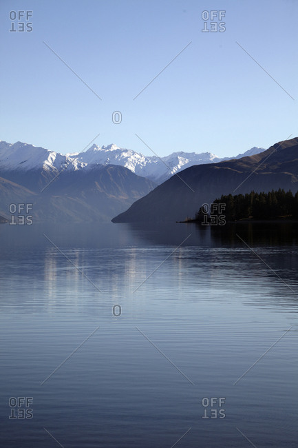 Scenic lake surrounded by mountain peaks