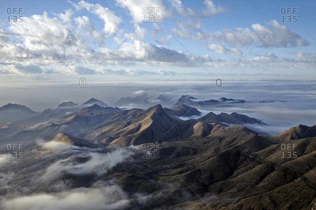 Scenic view of mountain ranges and clouds