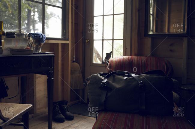Black bag on chair inside rustic cabin