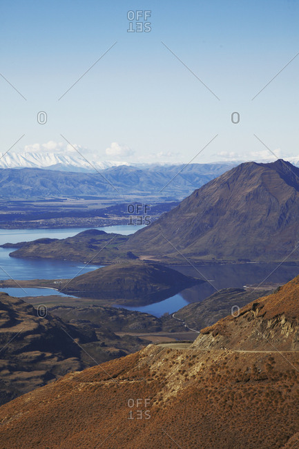 Scenic view of lake surrounded by mountain slopes