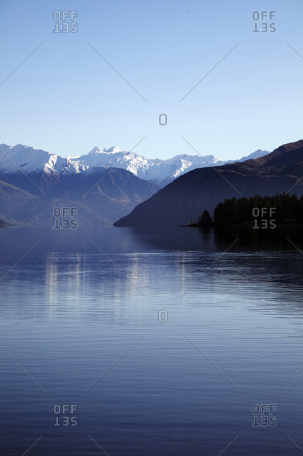 Deep blue lake surrounded by mountain peaks