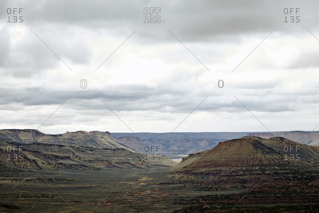 Range of plateaus and valleys in the desert on a cloudy day