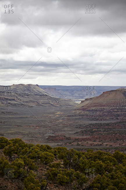 Scenic view of desert plateaus on a cloudy day