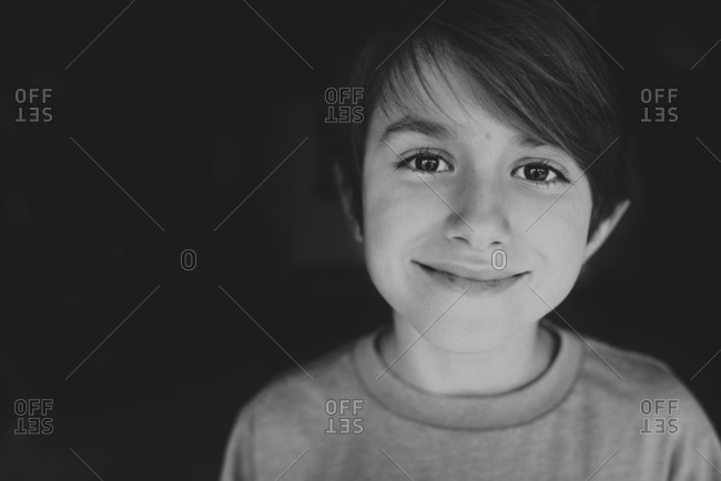 Portrait of a smiling boy in black and white