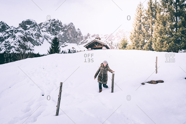 Woman walking in snow in rural Austria