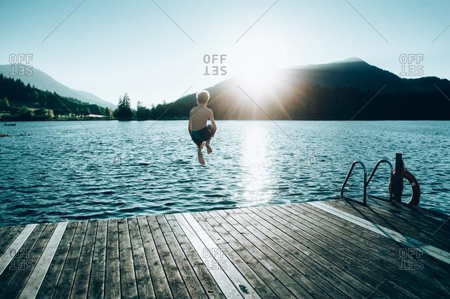 Boy diving into a lake in Austria