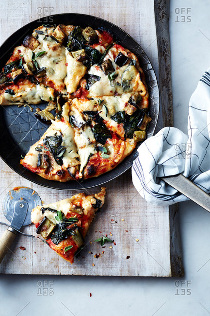Skillet pizza with eggplant and greens