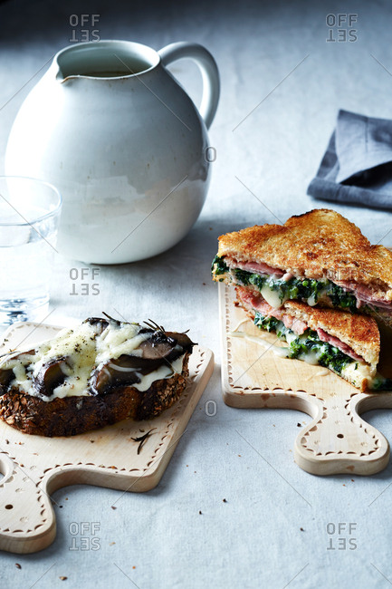 Grilled ham and broccoli rabe sandwich and a roasted Portobello melt