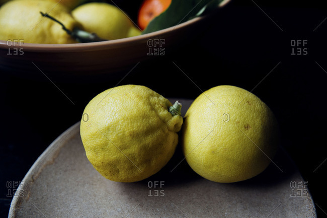 Fresh picked Bergamot oranges on stone tray