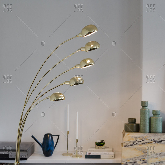Antwerp, Belgium - January 16, 2018: Gold lamp in a modern designed and decorated apartment in Antwerp